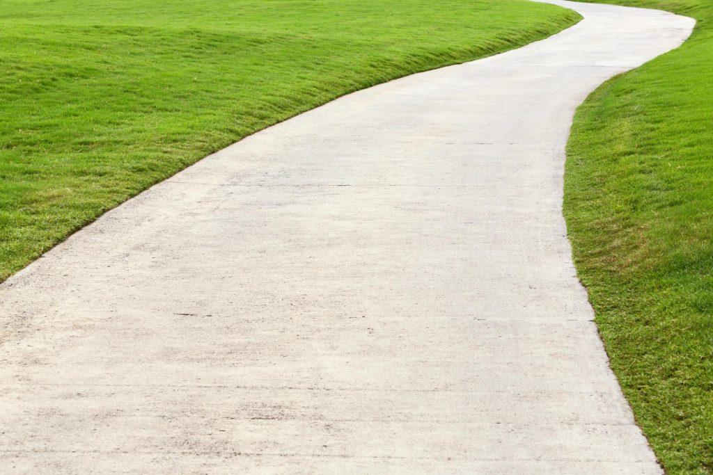 concrete side walk on the field